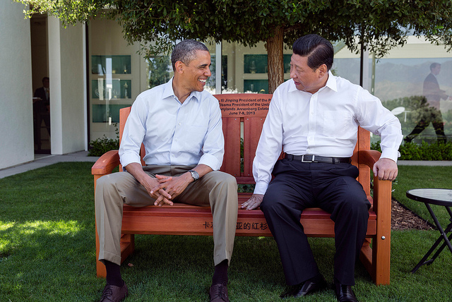 President Barack Obama presents President Xi Jinping of the People's Republic of China with a gift of an inscribed redwood park bench at the Annenberg Retreat at Sunnylands in Rancho Mirage, Calif., June 8, 2013. (Official White House Photo by Pete Souza)
