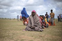 Women waiting for food aid at a distribution centre in Afgoye, Somalia.