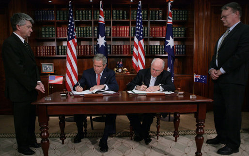 President George W. Bush and Australia's Prime Minister John Howard sign the Defense Cooperation Treaty following a meeting Wednesday, Sept. 5, 2007, at the Commonwealth Parliament Offices in Sydney. White House photo by Eric Draper