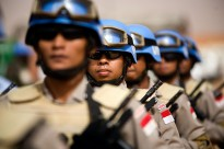 30 May 2010. El Fasher: Members of the Indonesia's Formed Police Unit (FPU) during the celebrations for the International Day of UN Peacekeepers in El Fasher UNAMID Arc Compound. Photo by Albert Gonzalez Farran / Unam