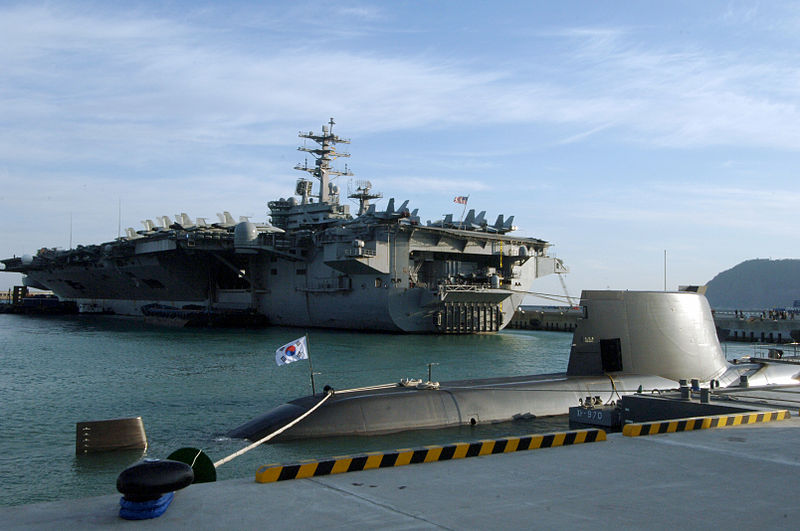 USS Nimitz (CVN 68) is moored near of the ROKS Son Won-il (SS 072), a Type 214 submarine, in Busan Naval Base, Republic of Korea.