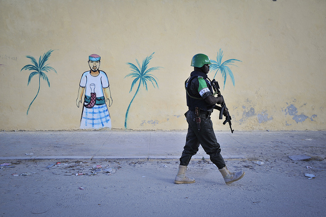 A Nigerian policeman walks by a newly built wall on a foot patrol near Lido beach in Somalia's capital, Mogadishu.