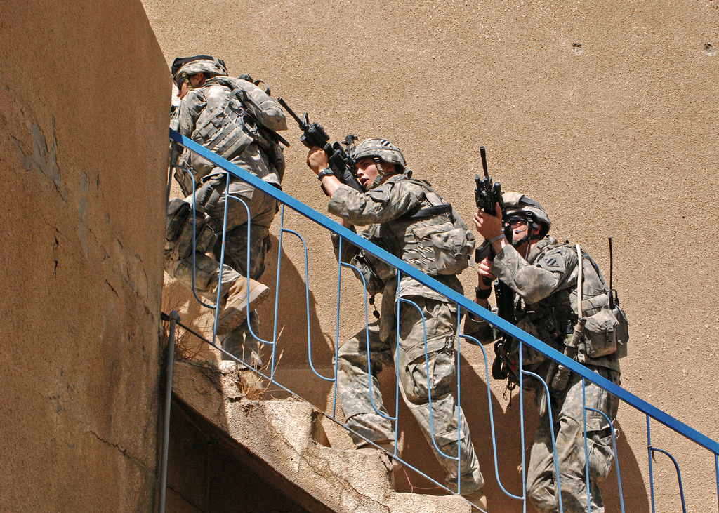 U.S. Army Soldiers from 1st Battalion, 30th Infantry Regiment, 2nd Brigade Combat Team, 3rd Infantry Division clear a house during a mission to clear insurgent strongholds in Baghdad, Iraq, June 26, 2007.