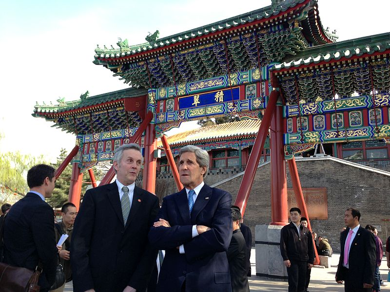 U.S. Secretary of State John Kerry, accompanied by longtime Chinese translator James Brown, stand in front of the South Gate to Beihai Park and look at Bai Ta, or the White Pagoda, at Beihai Park in Beijing, China, on April 13, 2013.