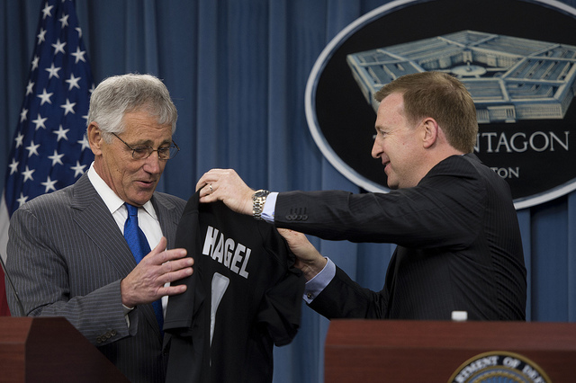 Secretary of Defense Chuck Hagel is presented a jersey for the New Zealand All Blacks Rugby team by New Zealand Minister of Defense Jonathan Coleman during a joint press conference in the Pentagon in Arlington, Va., on Oct. 28, 2013. Hagel and Coleman met earlier to discuss national and regional security items of interest to both nations. DoD photo by Erin Kirk-Cuomo. (Released)