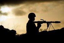 A Ugandan soldier serving with the African Union Mission in Somalia (AMISOM) holds a rocket-propelled grenade at sunrise, on the frontline in Maslah Town, on the northern city limit of Mogadishu.