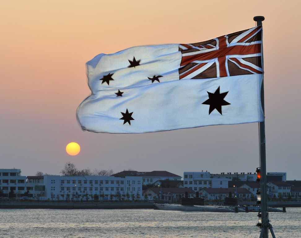 The Australian White Ensign (HMAS SUCCESS, against the Sunset in Qingdau, China)