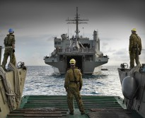 An LCM8 prepares to conduct a stern door marriage with HMAS KANIMBLA on arrival to Padang.