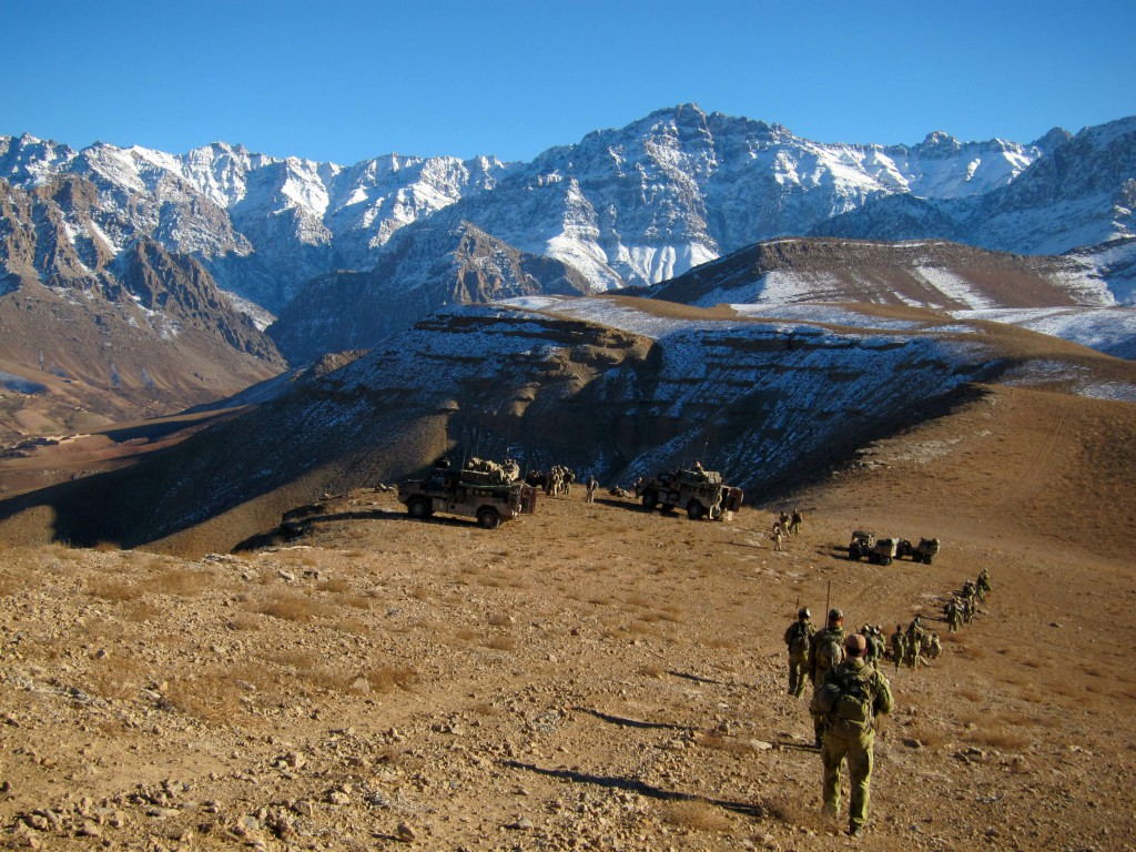 Australian Special Operations Task Group Soldiers patrol though snow peaked valleys in Northern Uruzgan.