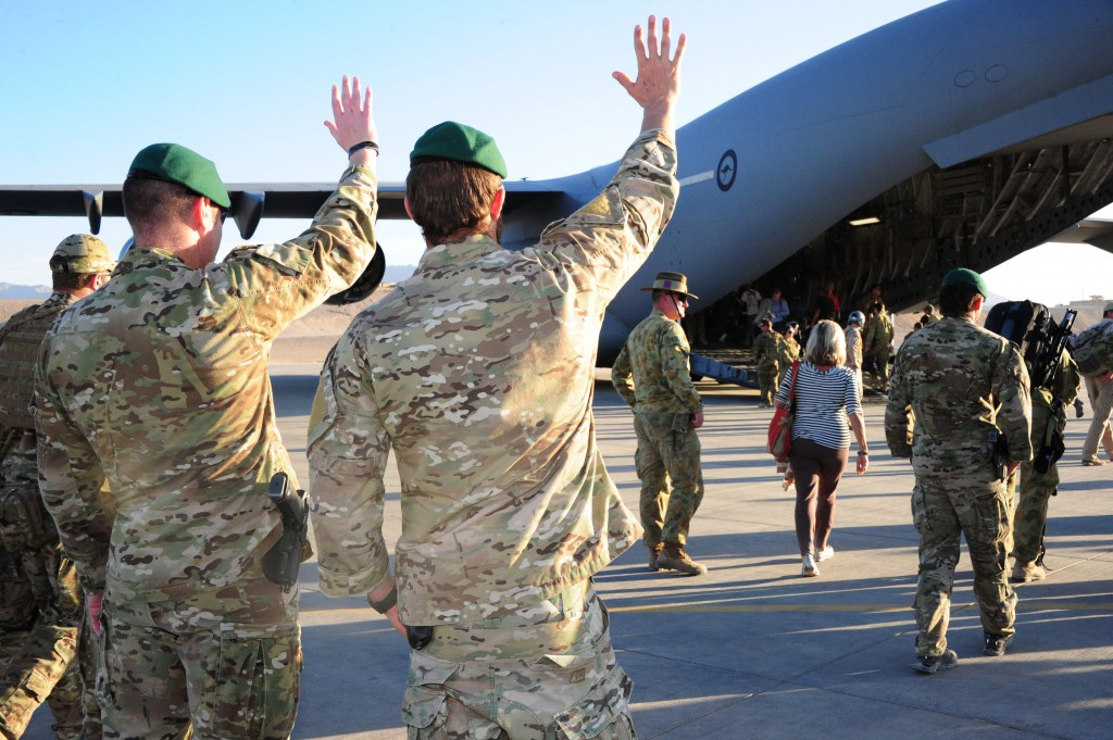 Australian Army soldiers from the Special Operations Task Group wave goodbye to the families of Australia's fallen after a ceremony at Multi National Base – Tarin Kot, southern Afghanistan.