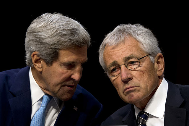 Secretary of State John F. Kerry confers with Secretary of Defense Chuck Hagel.