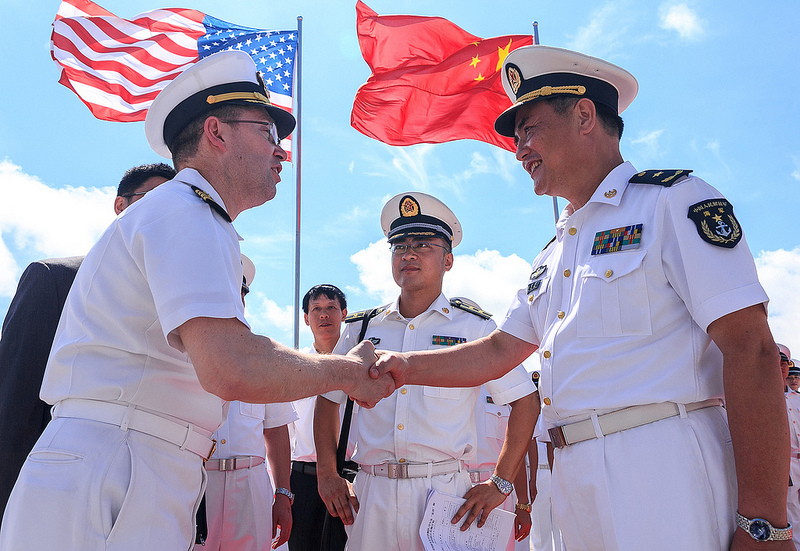 ZHANJIANG, China (May 30, 2013) - Capt. James T. Jones, commanding officer of the guided-missile cruiser USS Shiloh greets Rear Adm. Zhang Wendan, deputy chief of staff South Sea Fleet of the Chinese People's Liberation Army Navy during a ceremony welcoming the ship for a port visit.