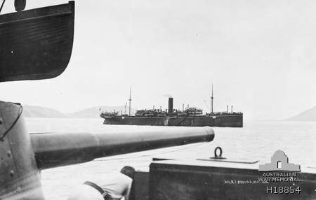 Queensland. August 1914. The Troopship Berrima at Palm Island with an escort ship and members of the Australian Naval and Military Expeditionary Force (AN&MEF) en route to Port Moresby and New Britain. (Purchased from C.N. King)