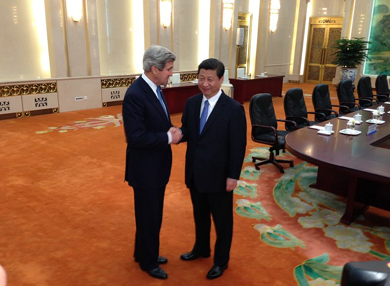 U.S. Secretary of State John Kerry is greeted by Chinese President Xi Jinping upon entering the Fujian Room at the Great Hall of the People in Beijing, China, on April 13, 2013.