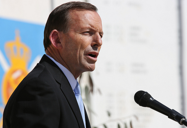 Australian Prime Minister Tony Abbott addresses the crowd at Multi-National Base Tarin Kot on Oct. 28, 2013 in Uruzgan, Afghanistan.