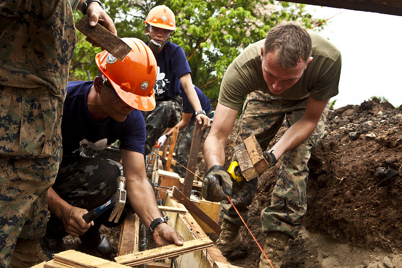 Armed Forces of the Philippines and US Marines members constructing a building at a school during Exercise Balikatan 2012