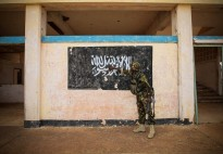 The flag of Al Shabaab painted on the wall of Kismayo Airport. When AMISOM troops moved into Al Shabaab's former stronghold in October 2013, they discovered around US$60 million worth of charcoal, a significant source of revenue for the group