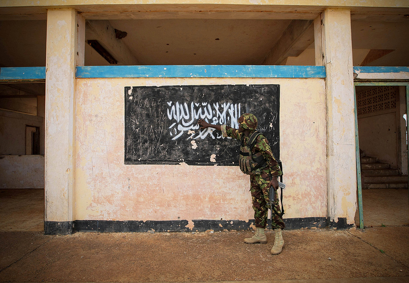 The flag of Al-Shabaab painted on the wall of Kismayo Airport. When AMISOM troops moved into the group's former stronghold in October 2013, they discovered around US$60 million of charcoal, a significant source of Al-Shabaab's revenue