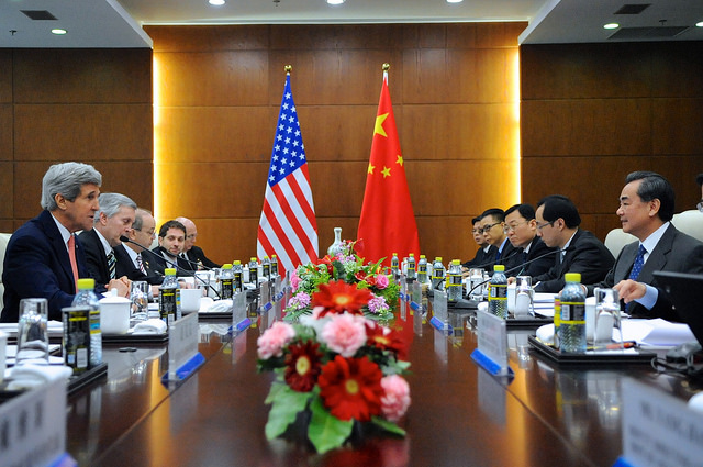 U.S. Secretary of State John Kerry and Chinese Foreign Minister Wang Yi sit across from one another at a meeting at the Ministry of Foreign Affairs in Beijing, China on February 14, 2014. [State Department photo/ Public Domain]