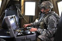U.S. Army Sgt. Robert Solberg with Engineer Troop, 4th Squadron, 2nd Cavalry Regiment, controls a Talon explosive ordinance disposal robot from inside an armored vehicle to destroy an improvised explosive device during pre-deployment training Feb. 20, 2013 at Grafenwoehr Training Area, Germany. The Troop used Husky Metal Detecting and Marking Vehicles, RG-31 Mk3a armored fighting vehicles and Buffalo Mine Protected Clearance Vehicles to conduct counter-IED training. U.S. Army Photo by Spc. Joshua Edwards