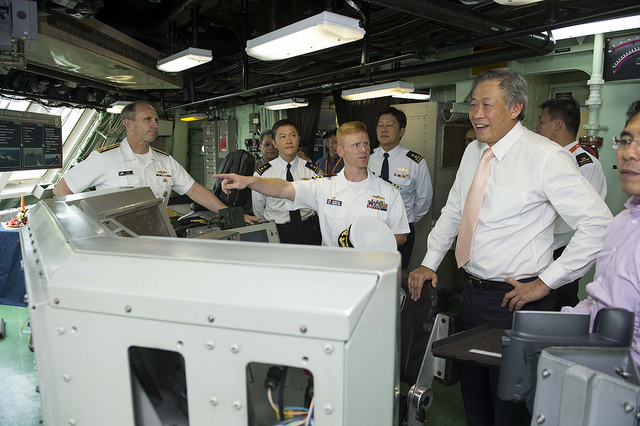 SINGAPORE (May 14, 2013) Republic of Singapore Defense Minister Dr. Ng Eng Hen, right, and Chief of Naval Operations (CNO) Adm. Jonathan Greenert are given a tour of the littoral combat ship USS Freedom (LCS 1) by the Gold crew commanding officer Cmdr. Timothy Wilke.