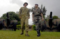 A Private from Australia's No.1 Armoured Regiment and a French Artillery officer at the French Marine Regiment's base in Plum, New Caledonia during Exercise Croix du Sud 2008. Independence movements in French territories in the Pacific have the potential to affect closer Australia-France defence ties.
