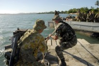 A French soldier and Australian officer help land a LARC at Poum, New Caledonia during Exercise Croix du Sud 2008. Independence movements in French territories in the Pacific have the potential to affect closer Australia-France defence cooperation in the region.