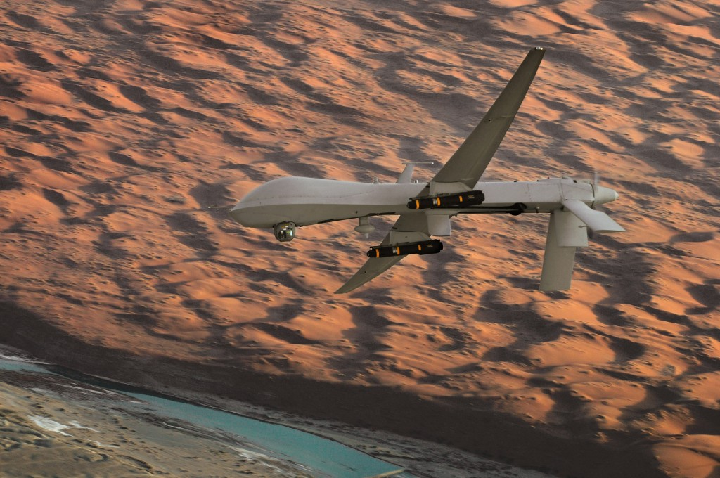 An MQ-1 Predator unmanned aircraft, armed with AGM-114 Hellfire missiles, flies a combat mission over southern Afghanistan