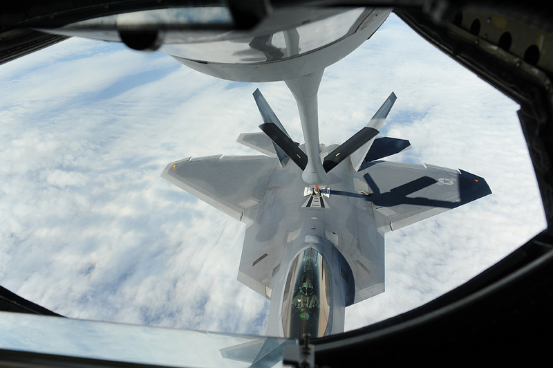 A U.S. Air Force KC-135 Stratotanker refueling aircraft refuels an F-22 Raptor fighter jet during a training sortie near Kadena Air Base, Japan. Raptors from Joint Base Langley-Eustis, Va., are deployed to Kadena to demonstrate the continued U.S. commitment to fulfill security responsibilities throughout the Western Pacific and to maintain peace in the region.