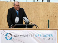 Senator the Honourable David Johnston, Minister of Defence addresses the invited guests at the keel laying of the second Air Warfare Destroyer at the ASC shipyards.