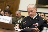 Chairman of the Joint Chiefs of Staff General Martin Dempsey prepares to testify before the House Armed Service Committee at the Rayburn House Office Building in Washington D.C. on March 6, 2014. Dempsey and Secretary of Defense Chuck Hagel addressed the 2015 Department of Defense Budget Proposal as remarked on the steps the Department has taken to separate itself from military cooperations with Russia in response to the situation in Ukraine. DoD Photo by Erin A. Kirk-Cuomo (Released)