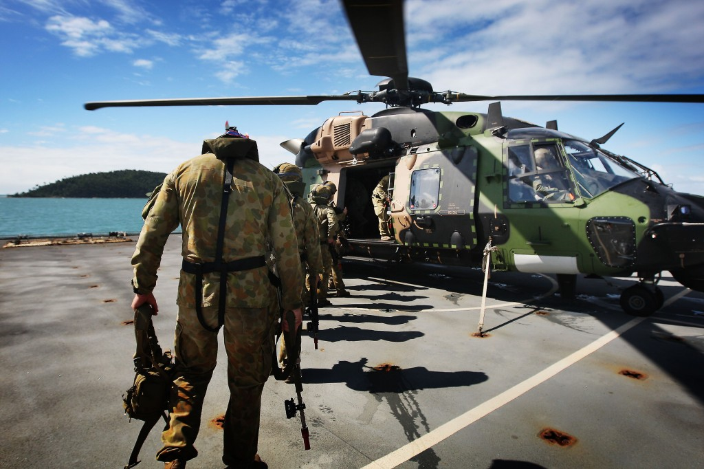 Soldiers from 2RAR board an MRH90 helicopter on the deck of HMAS Choules as they prepare to be inserted onto a beach in the AO of Exercise Sea Lion 2013. Will a new defence strategy focused on trade significantly change the current force structure?