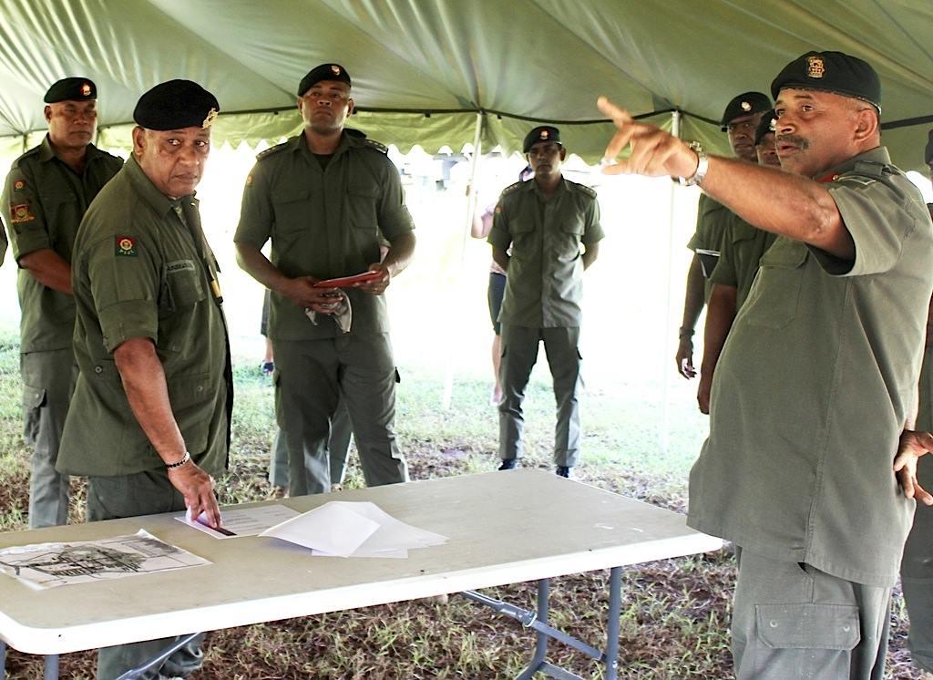 Commander Land Force Colonel Mosese Tikoitoga briefs Prime Minister Commodore Voreqe Bainimarama. It's been reported that Colonel Tikoitoga  will take over from Prime Minister Bainimarama as Commander of the Republic of Fiji Military Forces.