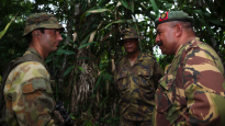 Lieutenant Aaron Swanson from A Company, 2nd Royal Australian Regiment speaks with Colonel Mark Goina Chief of Personnel, PNG Defence Force and Lieutenant Colonel Vince Gabina, Commanding Officer of 2nd Battalion Royal Pacific Island Regiment, PNGDF in Wewak, PNG during Exercise Olgeta Warrior.