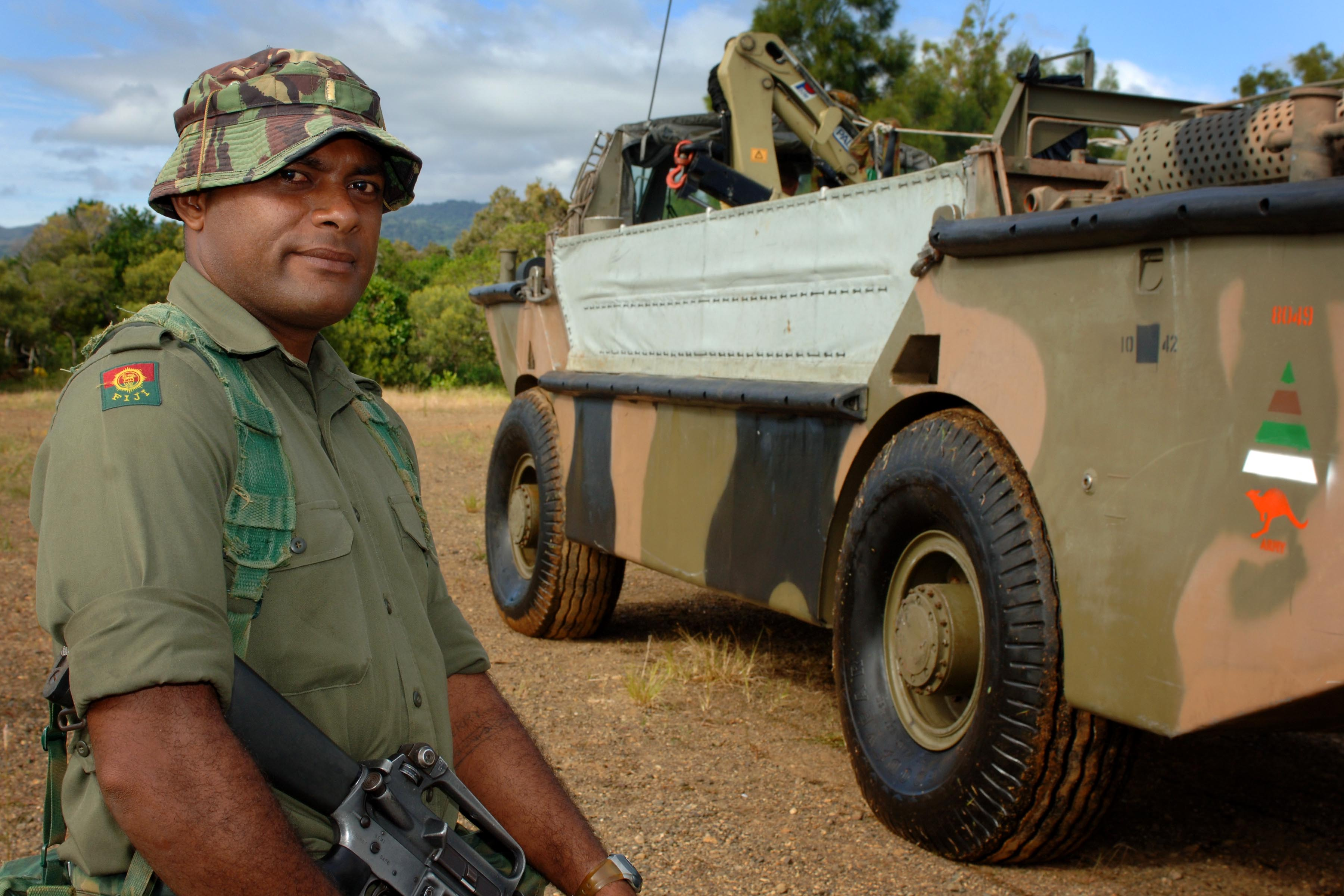 Fijian Army Private Qiri desembarked from Lighter Amphibious Resupply Cargo (LARC) at Canala Bay