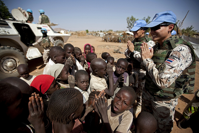 This photo shows peacekeepers from Thailand on patrol at the camp for refugees from the Central African Republic (CAR) in Muhkjar (West Darfur). They are showing the children how to greet in according to Thai tradition.