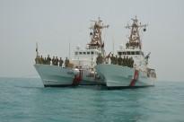 US Coast Guard vessels Cutters Adak and Monomoy.