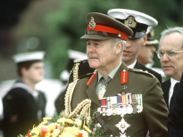 """GEN Sir Phillip Bennett, royal governor of Tasmania, prepares to place a wreath at a memorial during a service, part of ceremonies commemorating the 50th anniversary of the Battle of the Coral Sea."" (May 1982)"