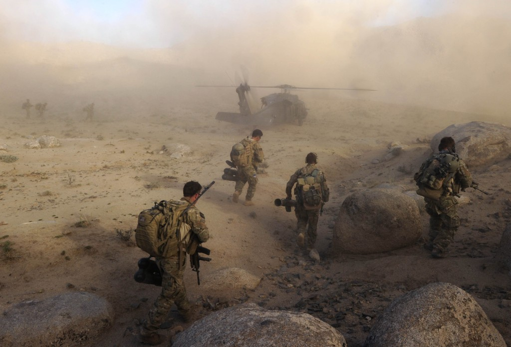 Special Operations Task Group soldiers make their way to a waiting UH-60 Blackhawk helicopter after a Shura in Sha Wali Kot, Kandahar Province, Afghanistan