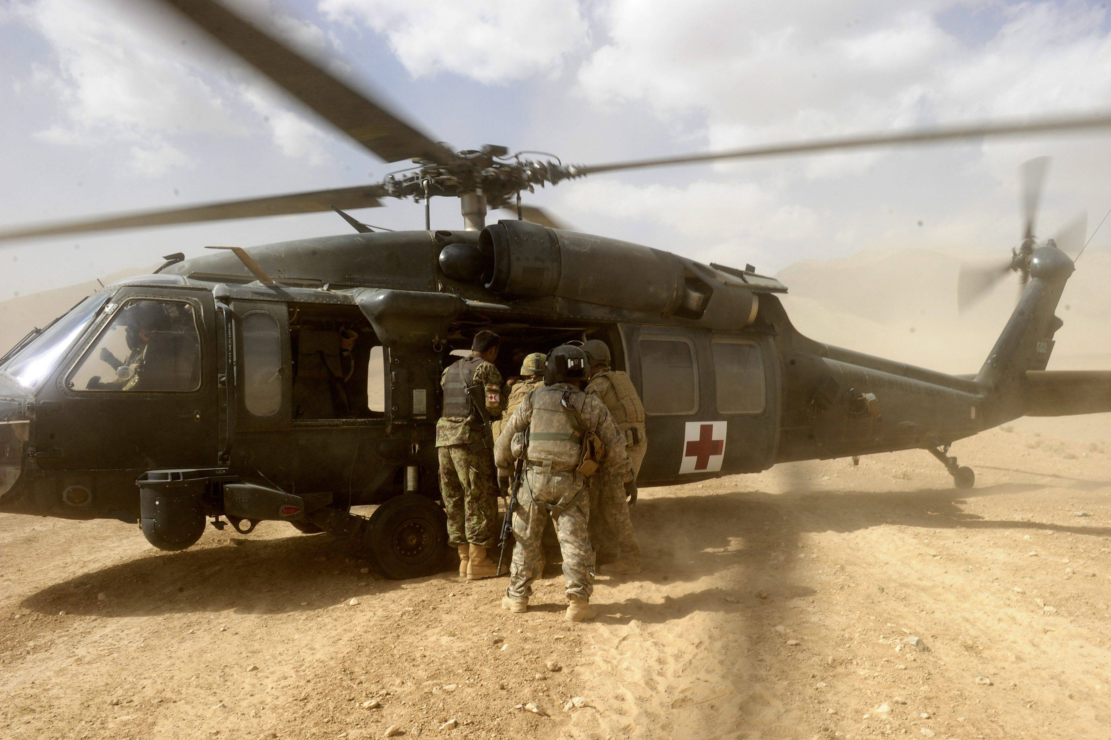 Three injured soldiers from Mentoring Task Force – Three (MTF-3) are Aero medical Evacuated (AME) to the medical facilities in Tarin Kot, after an Improvised Explosive Device (IED) attack on a Protected Mobility Vehicle Bushmaster, during a route clearance in the Chora Valley, Southern Afghanistan.