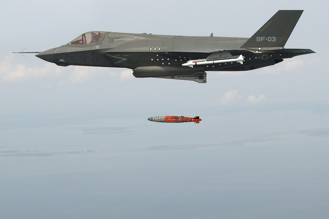 An F-35B completes a test aerial weapons release with an inert 1,000-pound GBU-32 Joint Direct Attack Munition over an Atlantic Ocean test range.