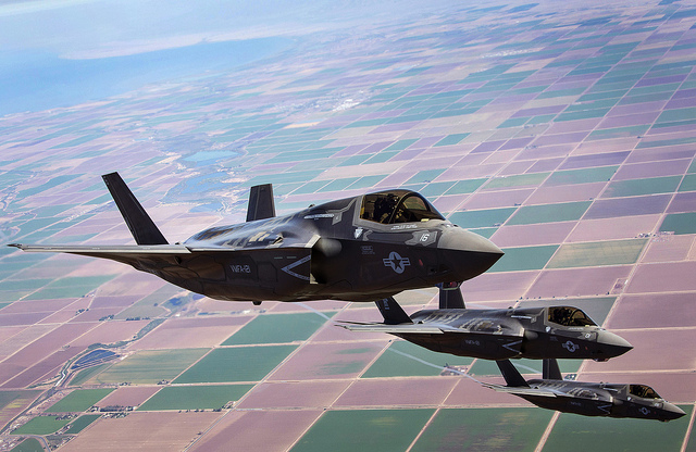 Three F-35B Lightning II Joint Strike Fighters with Marine Fighter Attack Squadron 121, 3rd Marine Aircraft Wing, fly in formation during fixed-wing aerial refuelling training over eastern California, Aug. 27, 2013.