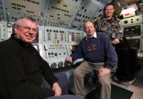 Defence Materiel Organisation General Manager— Submarines, Mr David Gould (left) and Chief Executive Officer ASC, Mr Steve Ludlum (right) in the control room of HMAS Sheean with Marine Engineering Officer, Lieutenant Commander Lindsay Gordon, RAN. The Commission of Audit recommended the merger of DMO back into the Department of Defence and the sale of ASC.