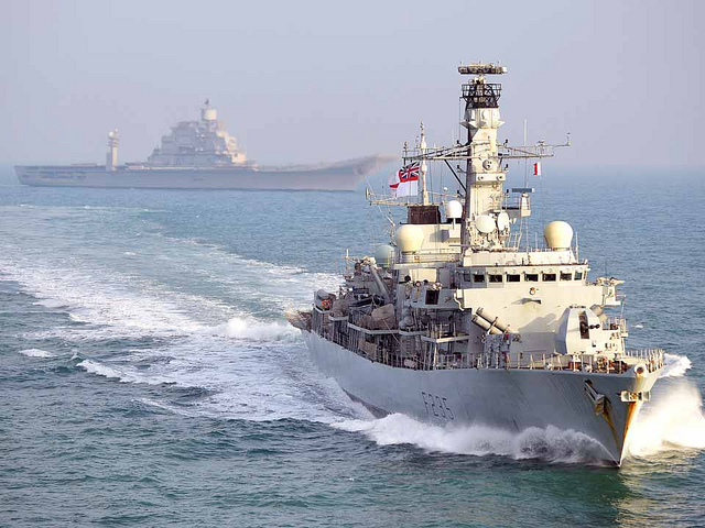 HMS MONMOUTH sails in company with Carrier INS VIKRAMADITYA.