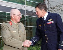 Newly promoted General David Hurley AC, DSC is congratulated by Air Chief Marshal Angus Houston AC, AFC on his promotion and transfer of authority as the new Chief of Defence on 1 July 2011. Over the nine years of their tenures, they served with five different Secretaries of Defence.