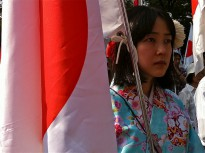 A Japanese woman in traditional dress participates in a protest regarding territorial claims to the Senkaku/Diaoyu Islands. Nationalism is increasing in Japan and is putting pressure on its pacifist constitution.