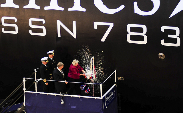 Ellen Roughead, wife of former Chief of Naval Operations (CNO) Adm. Gary Roughead and sponsor of the Virginia-class attack submarine Pre-Commissioning Unit (PCU) Minnesota (SSN 783), breaks a bottle to christen the boat.