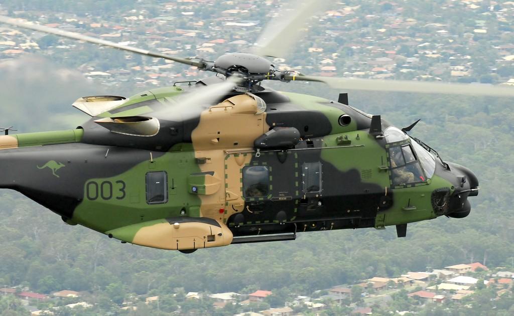 An Australian Multi-Role Helicopter (MRH 90) flies over Brisbane.
