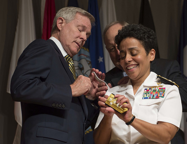 WASHINGTON (July 1, 2014) Adm. Michelle Howard lends a hand to Secretary of the Navy (SECNAV) Ray Mabus as he and Wayne Cowles, Howard's husband, put four-star shoulder boards on Howard's service white uniform during her promotion ceremony at the Women in Military Service for America Memorial. Howard is the first woman to be promoted to the rank of admiral in the history of the Navy and will assume the duties and responsibilities as the 38th Vice Chief of Naval Operations from Adm. Mark Ferguson. (U.S. Navy photo by Chief Mass Communication Specialist Peter D. Lawlor/Released)