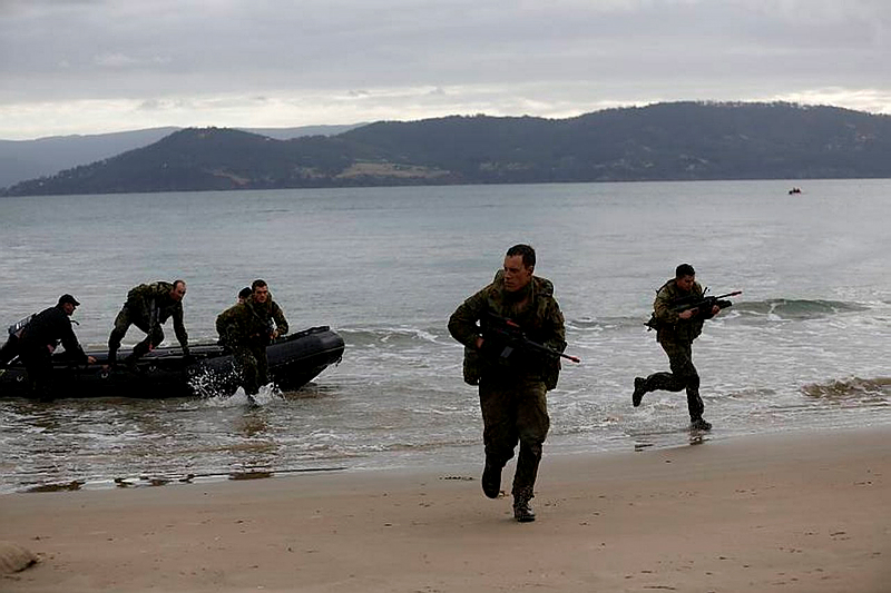 Australian Army Reserve soldiers from the 12th/40th Battalion, The Royal Tasmania Regiment, training in waterborne patrolling with a Zodiac from the Hobart-based Navy Reserve Diving Team 10.
